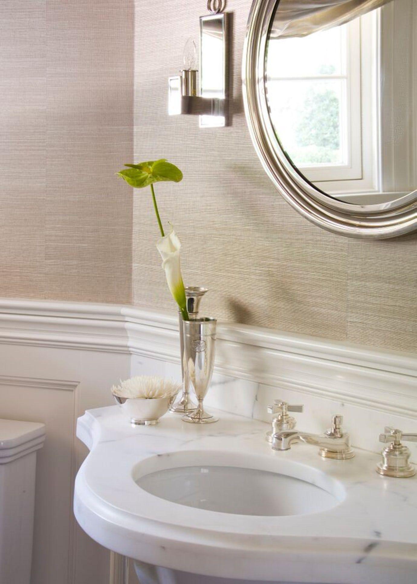 Grasscloth wallpaper is a subtle nod to the home's coastal