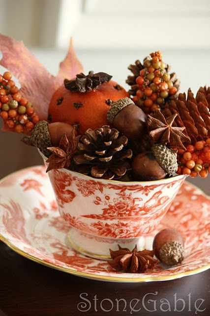 A teacup,pine cones,acorns,and misc. fall decor accents-( just takes a few minutes to put together)-Pretty!
