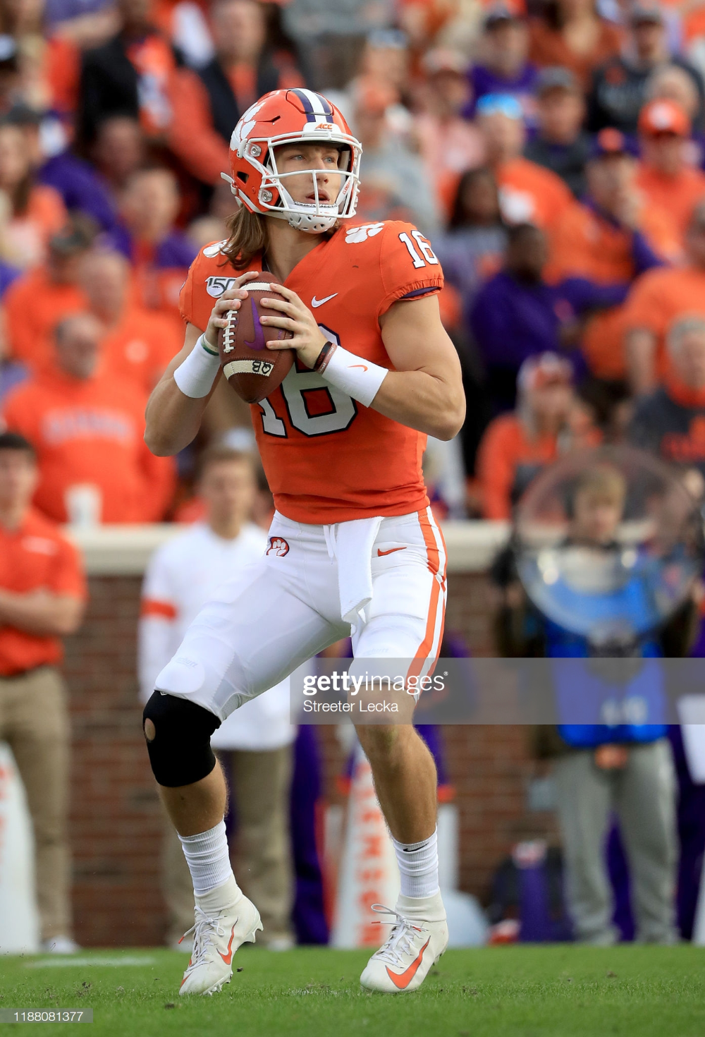 Trevor Lawrence of the Clemson Tigers drops back to pass
