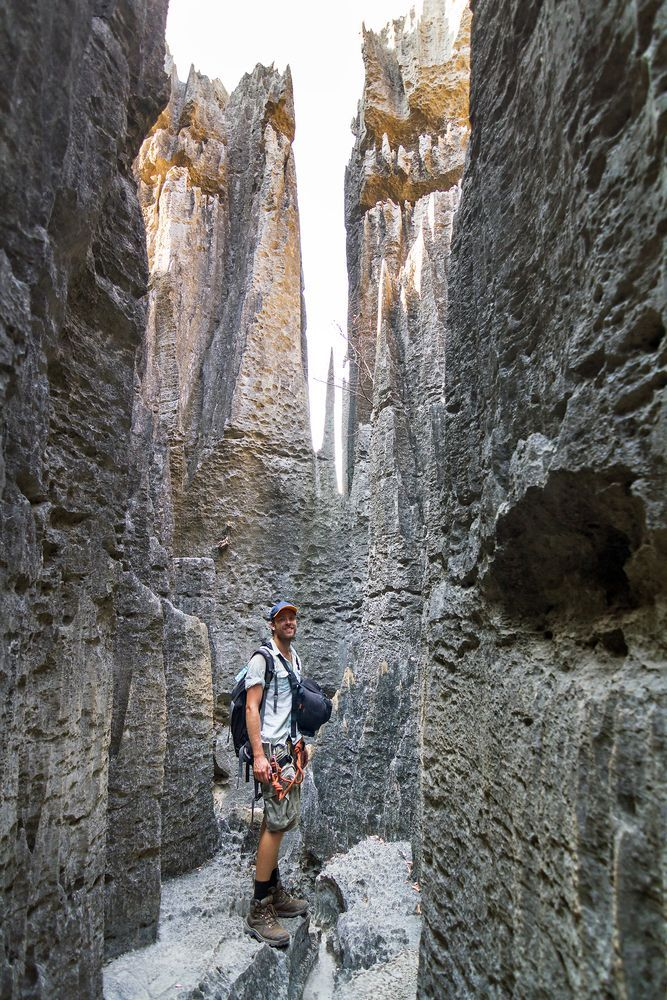 Tourist hiking through the rock formations of Tsingy de Bemaraha 835485f1732