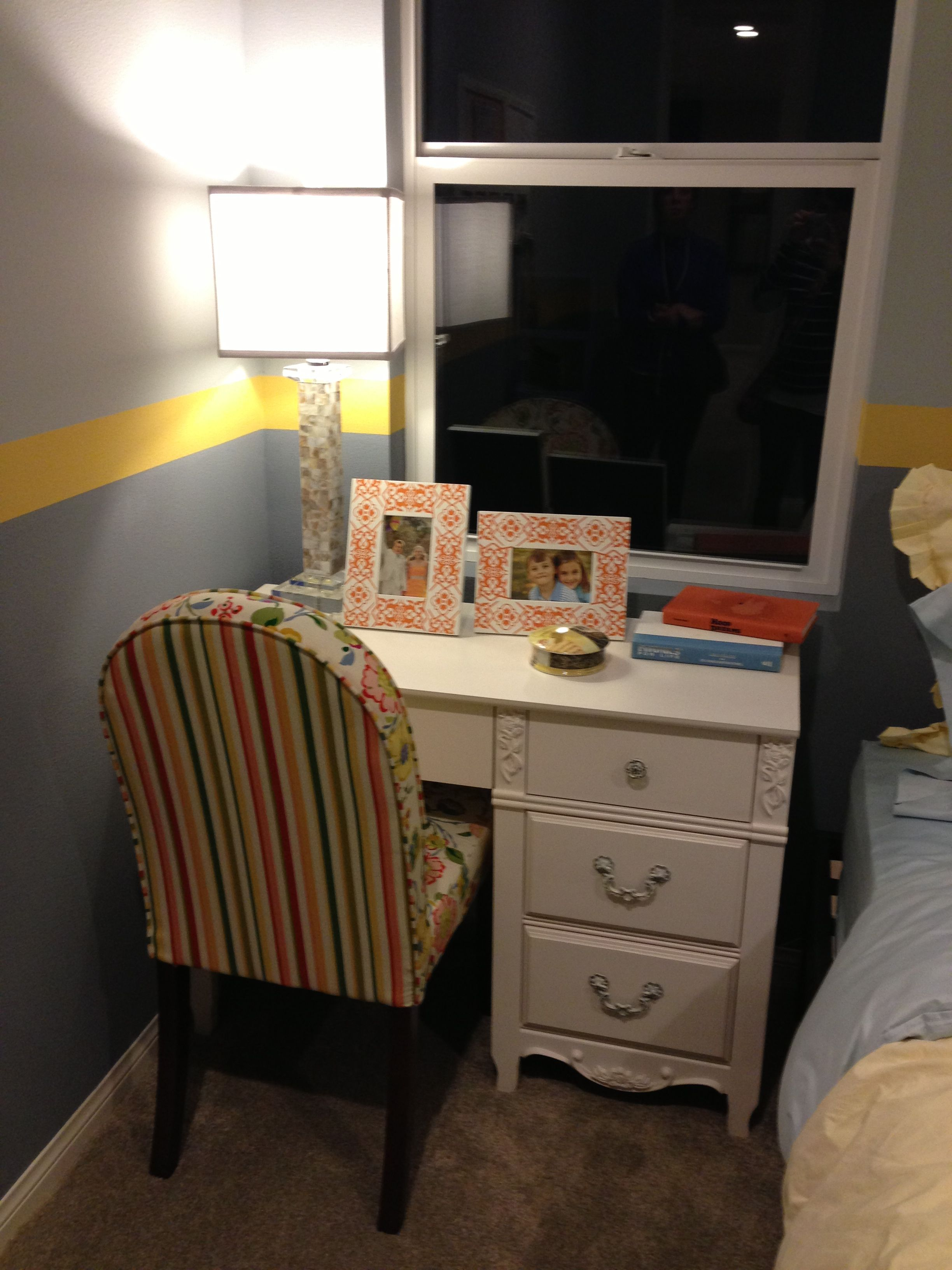 blue and yellow room with orange accents, super cute desk area