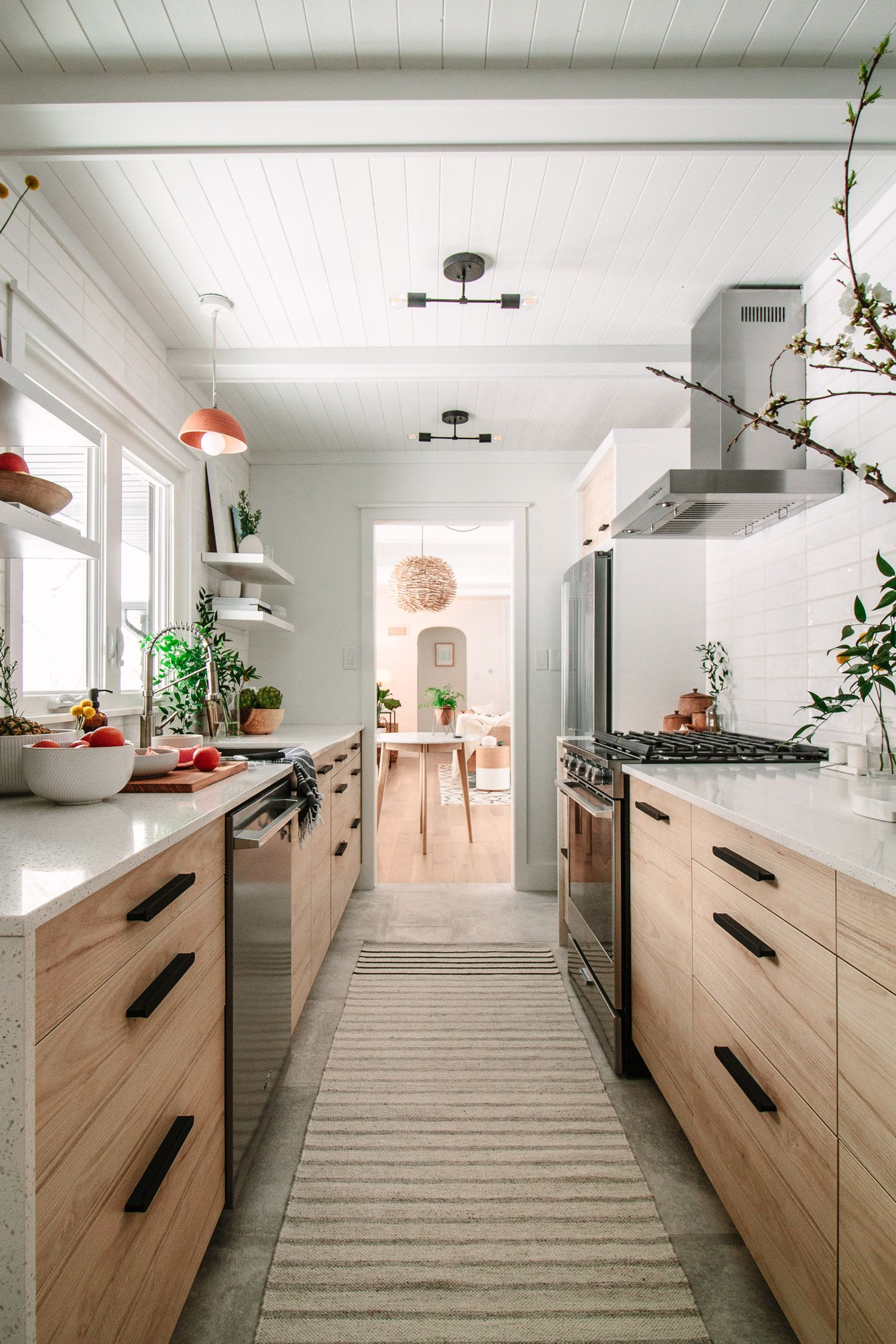 A Drab Galley Kitchen Gets A Modern Transformation At The Midwest Malibu Cottage - Front + Main
