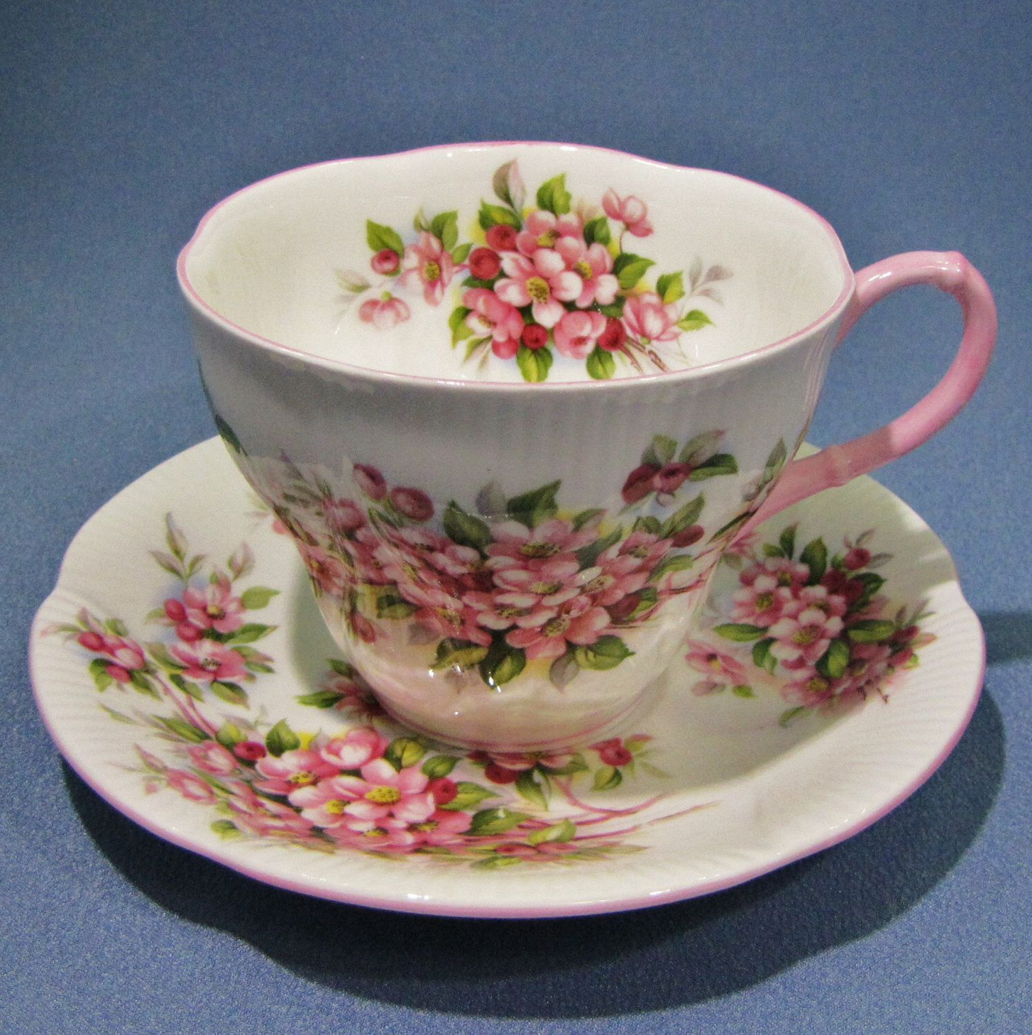 ROYAL Albert APPLE BLOSSOM Tea Cup and Saucer, Blossom Time Series, Pink Shelley Shape, Pink Handle, Made in England, Fine Bone China by Thinkilikeit on Etsy https://www.etsy.com/ca/listing/478246632/royal-albert-apple-blossom-tea-cup-and