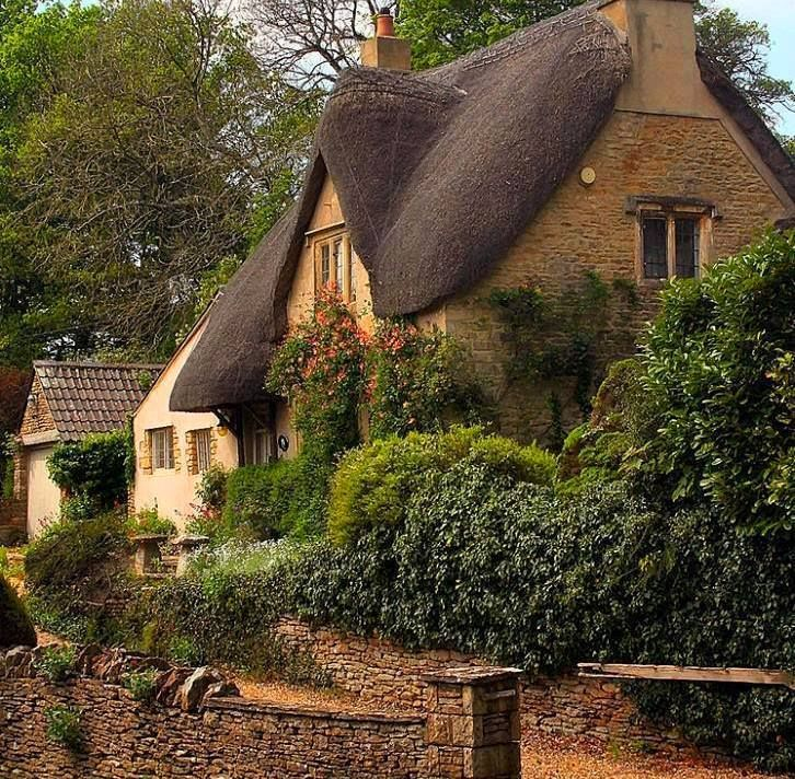 Thatched Cottage At The Corner Of Dunns Lane And The Street In