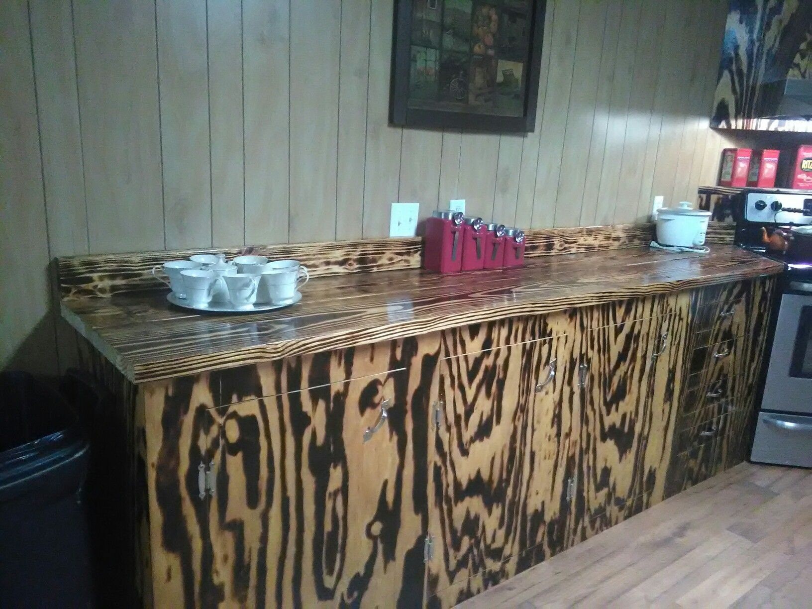 Cabinets And Countertops Made From Burnt Pine Wood Kitchen