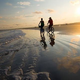 bicycle rides on the beach .. yeah !!