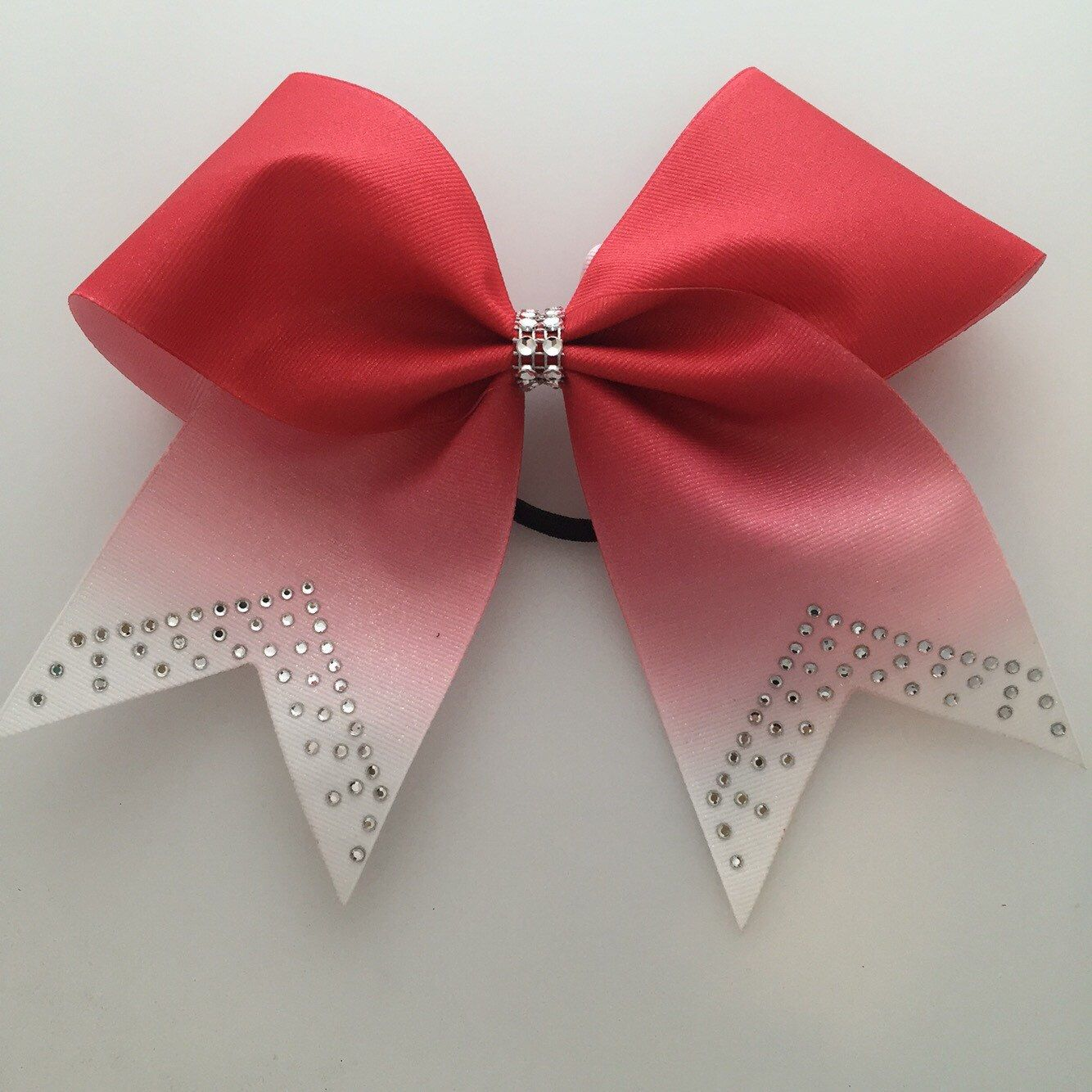 A personal favorite from my Etsy shop https://www.etsy.com/listing/264026908/red-glitter-ombre-cheer-bow-with