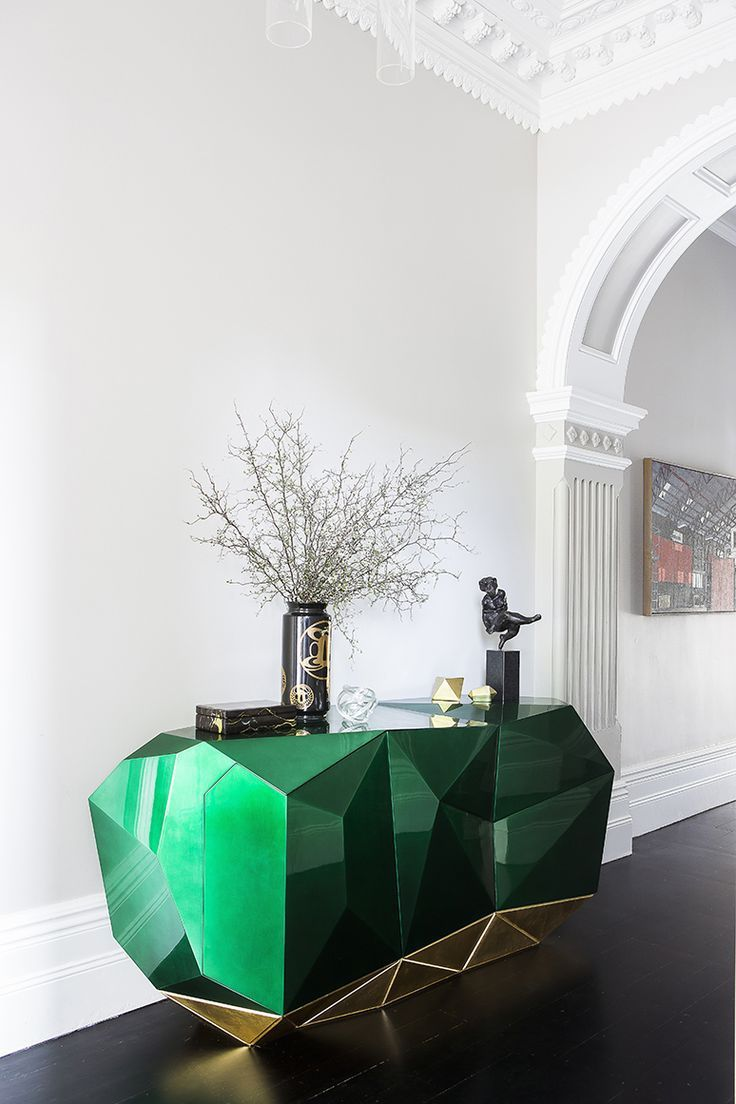 Entryway complete with emerald green cabinet. Interior by Brendan Wong Design.