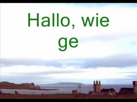 Learn German - Lesson 01 - Deutsch mit Julia - Kieron laed Elaine zum Fr...