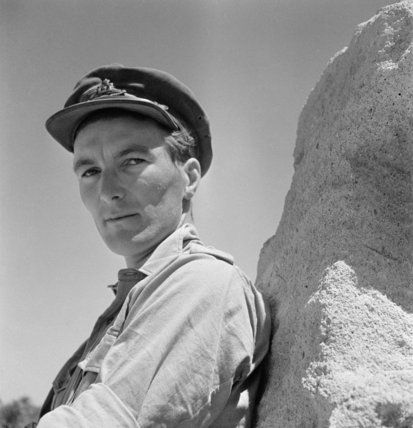 Beaton, Cecil -- Cecil Beaton portrait of a Royal Artillery officer leaning against a rock in the Western Desert, 1942