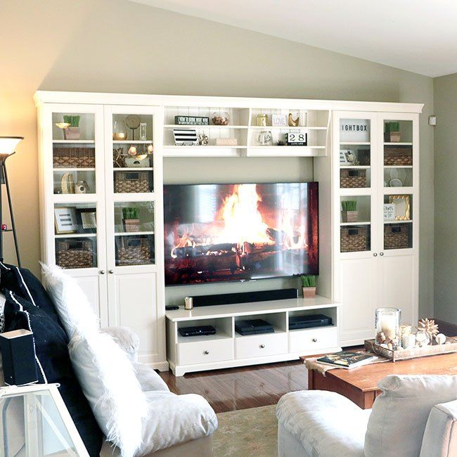 Tips On How To Decorate Bookshelves Around A TV is part of Ikea Living Room Liatorp - Bookshelves can hold A LOT of space and decorating them can be intimidating  However, I may it easy with some tips on how I decorated these Liatorp bookshelves…