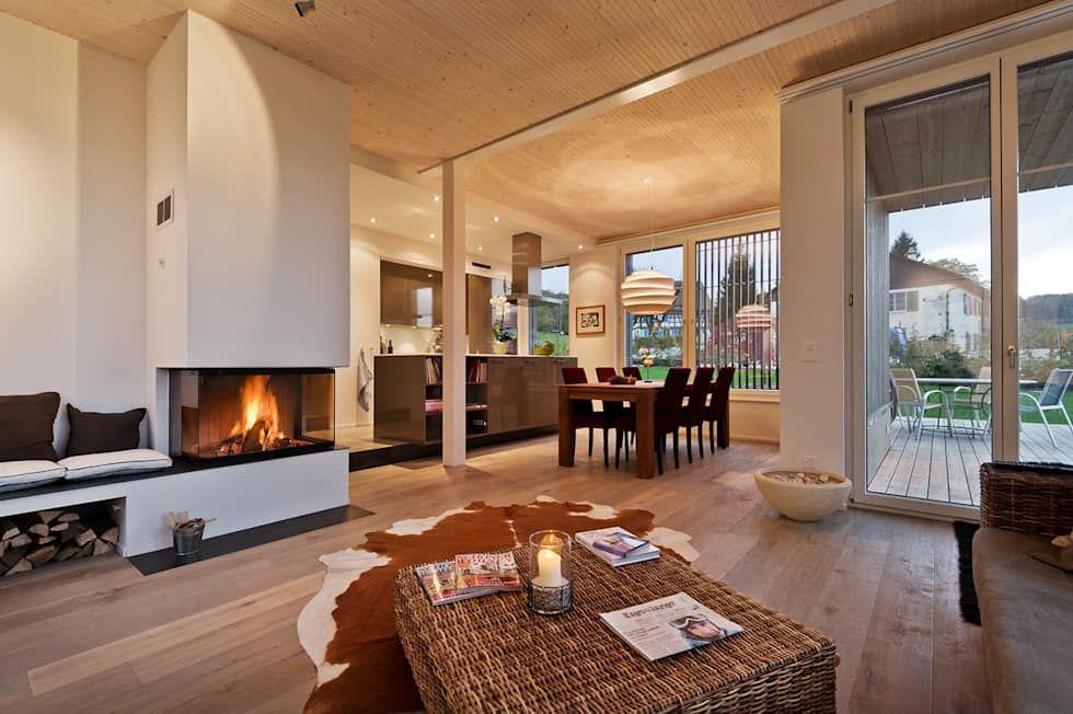 Efh huggenberg landhausstil wohnzimmer von giesser architektur +