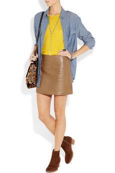 Leather skirt and mustard color top. Cute