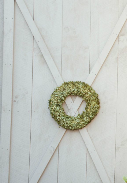 wreath on grey barn door