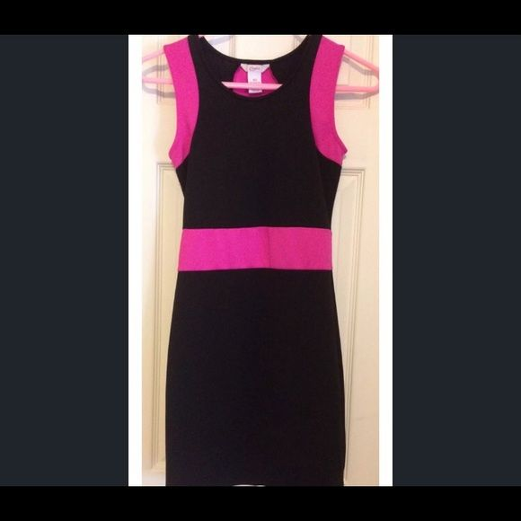 Candies dress. XS Hot pink& black. Very form fitting. It is used but in great shape. Xsmall. Hits a little above knee ; I'm 5'3 Candies Dresses Asymmetrical