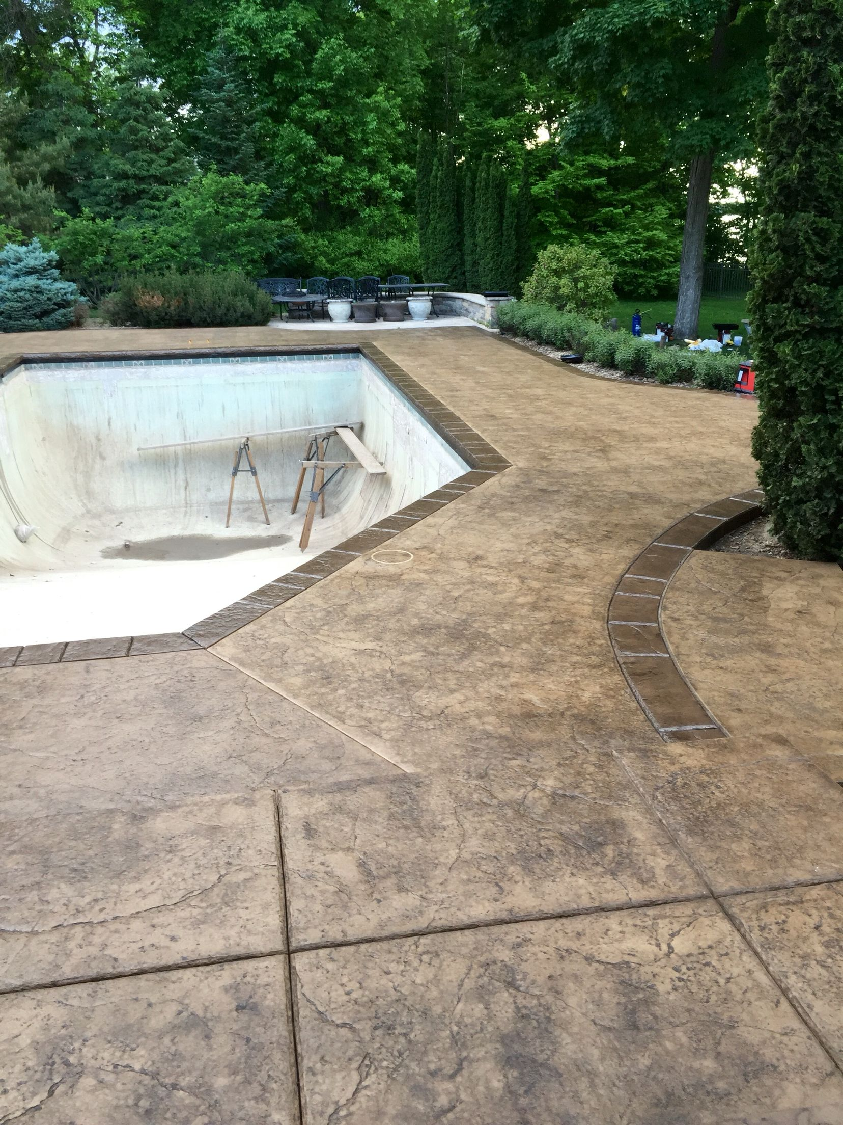Stamped concrete pool deck with custom chiseled stone for Concrete pool