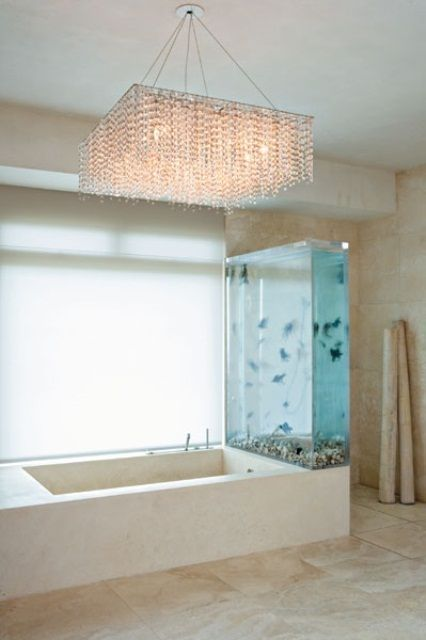 The Large Crystal Light Fixture Suspended Over The Bathtub In