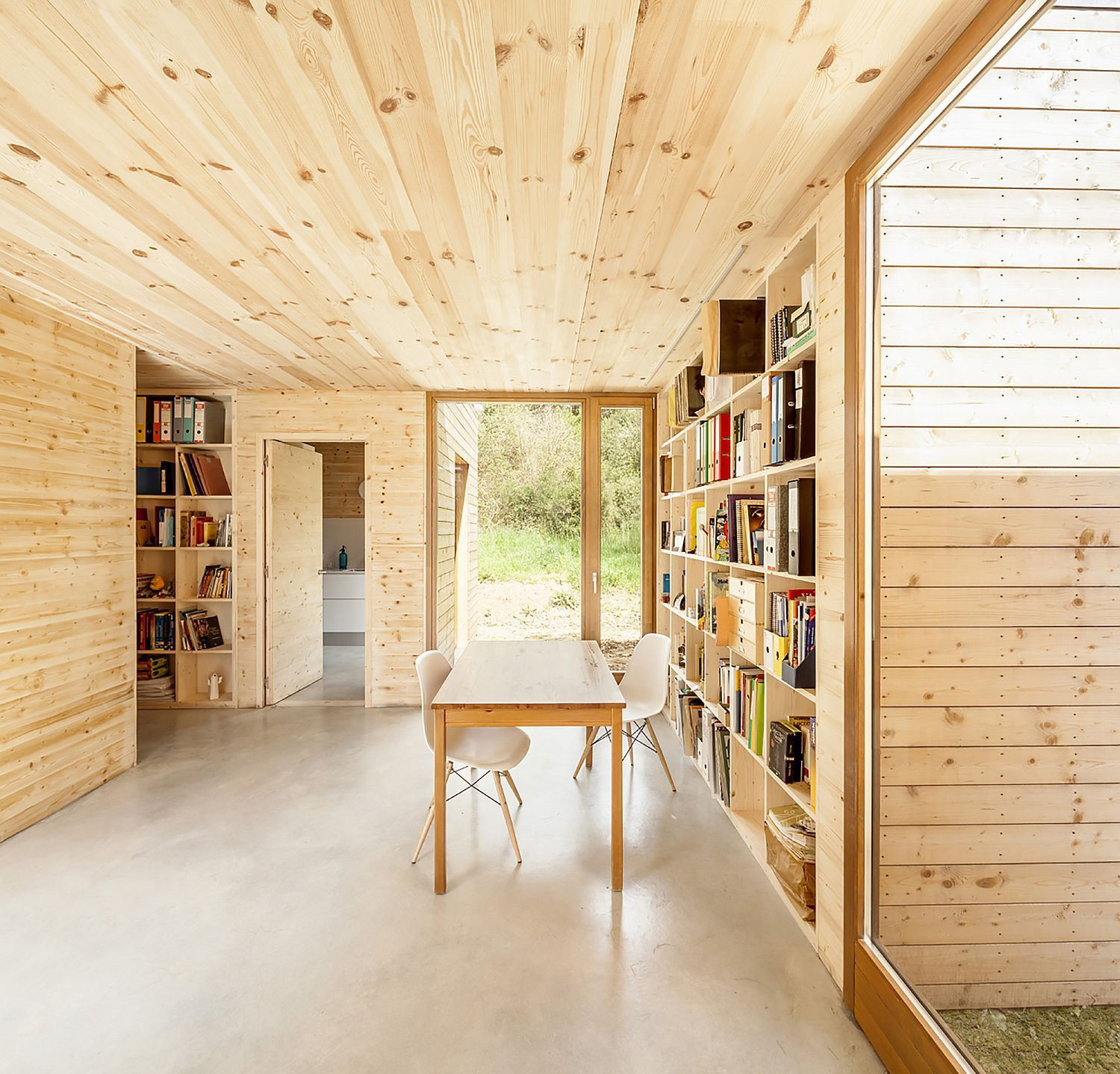 A passive house in Spain composed of six prefabricated wood boxes. It has 3 bedrooms in 1,195 sq ft.