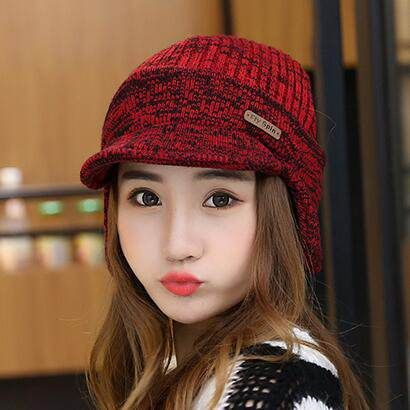 Womens warm knit hat with ear flaps for winter wear  529ab5cf0c5