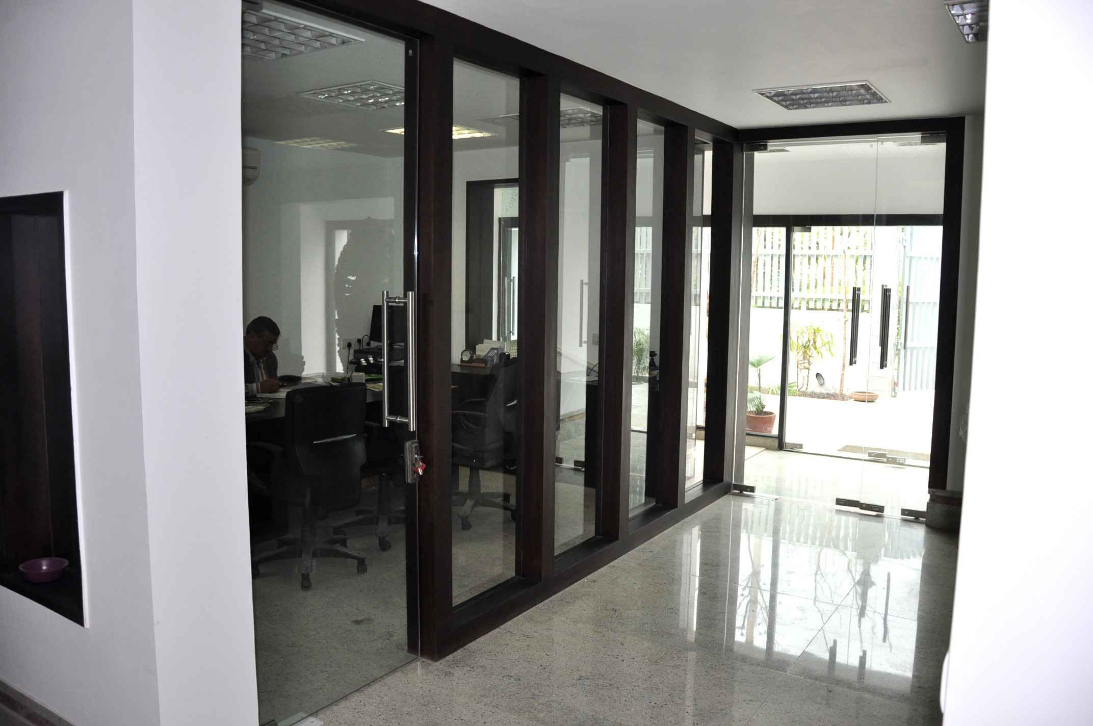 The Corridor Contains Office Cabins And Meeting Spaces On Either Sides Enclosed By Glass