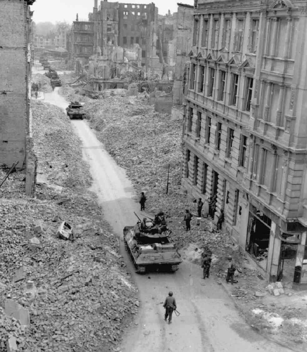 TANK DESTROYERS moving through the destroyed town of Magdeburg. Scenes such as this were found in many German cities by the advancing Allied forces. Most of the buildings were reduced to rubble by aerial attacks and artillery shelling, and many streets had to be cleared before the troops and vehicles could pass.