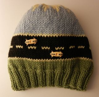 This hat was inspired by a hat described on a Savvy Girls podcast. It is fun to knit, and goes quickly. It is very easy to personalize with your own auto buttons, or pins. Have fun with it!