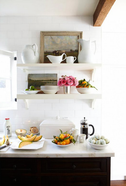 Inside a Bungalow That Maximizes Its Small Space// open shelving, art in kitchen, white subway tile