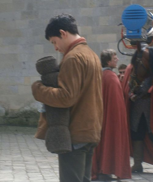 Colin Morgan checking his phone, which is in the pocket of his jacket ! Yes I saw him : ) <--quote from tumblr