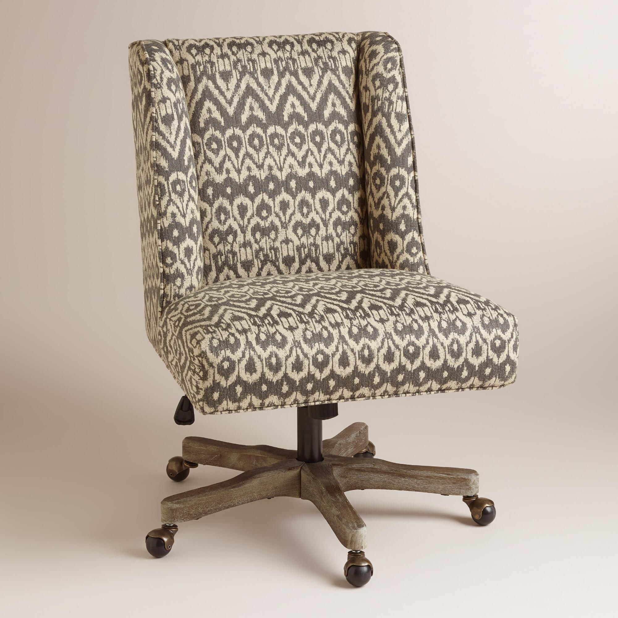 4a7e2f26c07 With an updated wingback profile and charcoal gray ikat-patterned fabric  upholstery