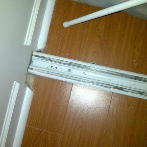 Closet door bottom tracks