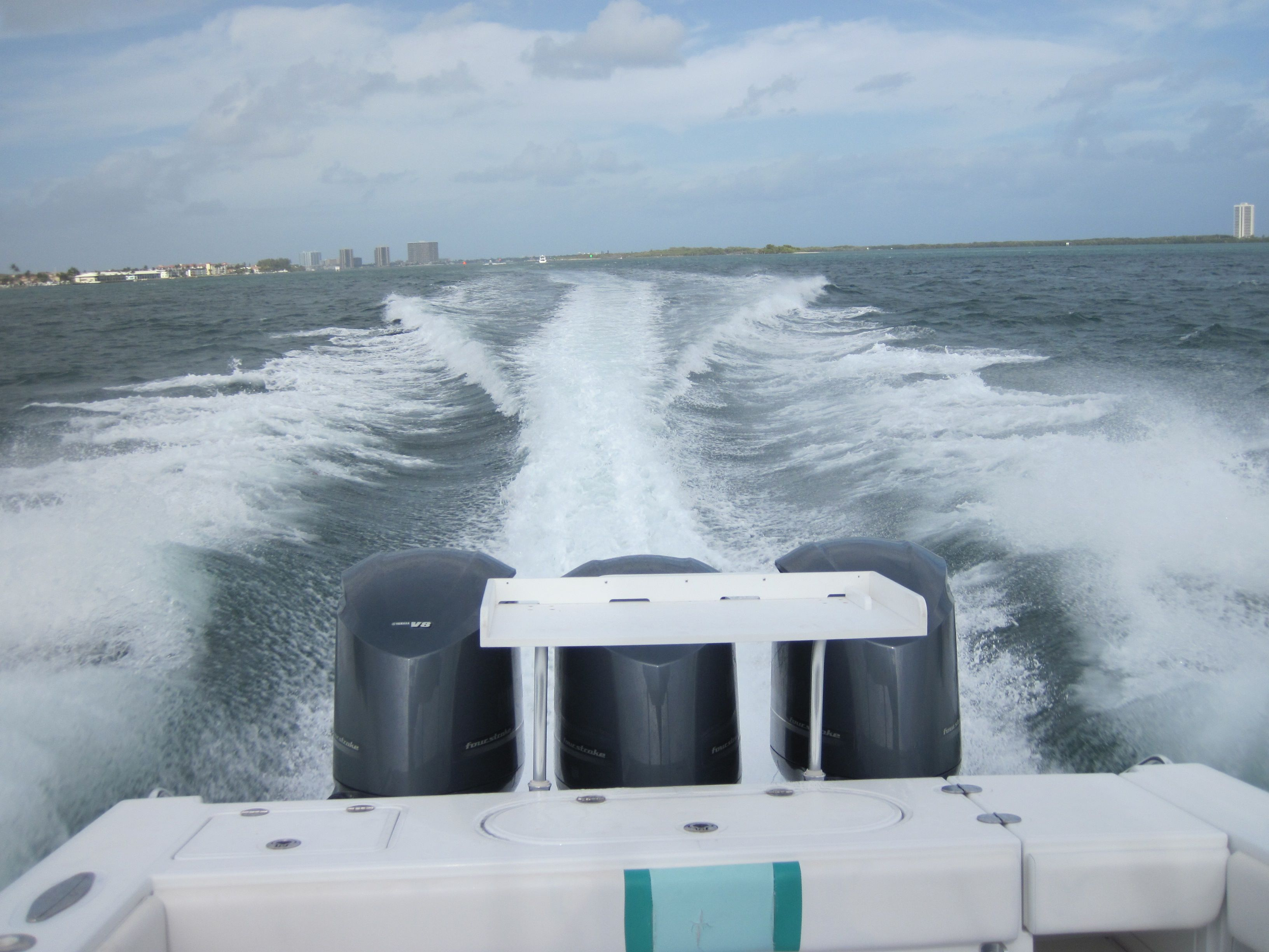 Full prepurchase survey and outboard engine survey on a