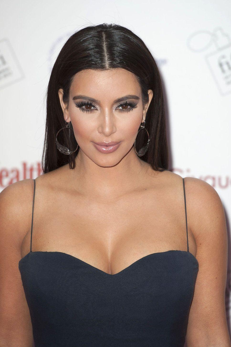 Kim Kardashian navy blue dress long black straight hair parted do ...