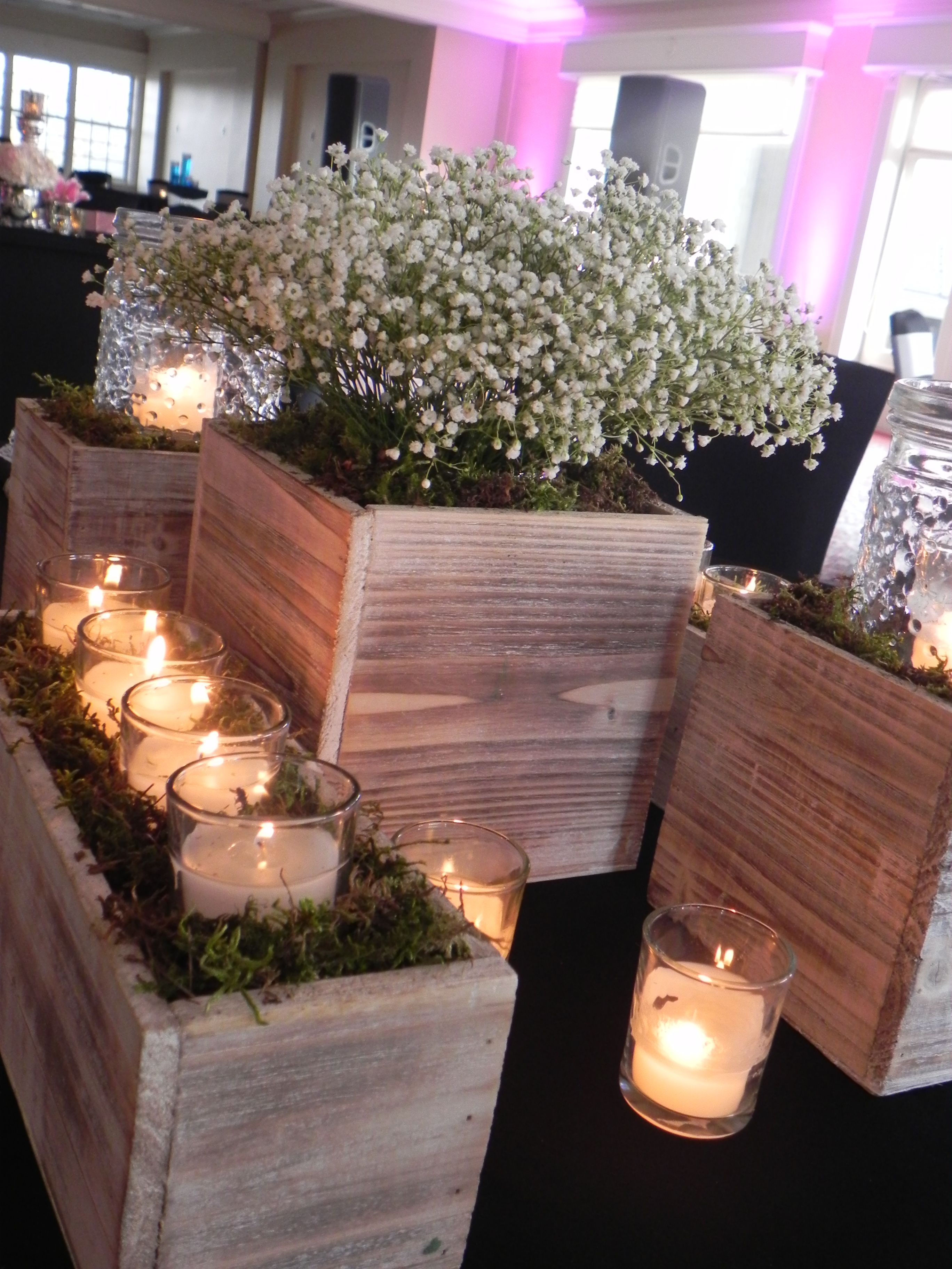 Elegant rustic centerpieces whitewashed wooden boxes with babys elegant rustic centerpieces whitewashed wooden boxes with babys breath and votives make for a beautiful setting for any wedding reception junglespirit Images