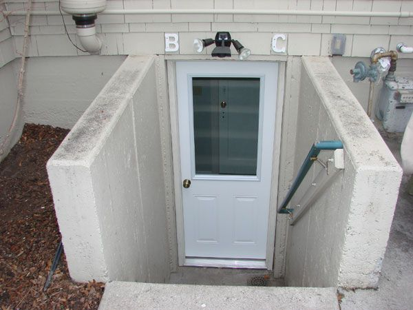 basement apartment entrance. basement entrance  Basement apartments B and C shared patio exterior