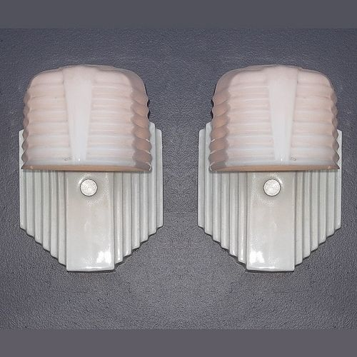 Typical 1930s - 40s white porcelain fixtures with milk glass shades.   75 watt max   Height: 6 1/2 inches   Width: 5 inches   Projection: 8 inches.    http://www.vintagelights.com/product/1/pair-white-porcelain-vintage-bath-or-kitchen-wall-light-fixtures.html