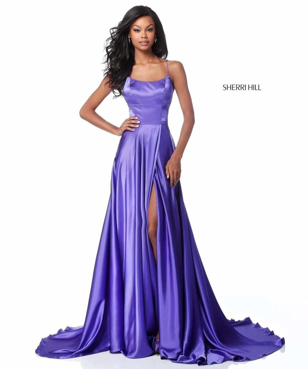 c912718c0cb Style 51631 from Sherri Hill is a spaghetti strap prom gown with a high  slit in the A-line skirt and an open lace-up back.