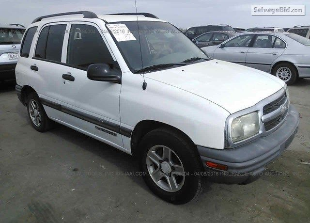 Salvage White Chevrolet Tracker On Online Auction At Wilmer Tx