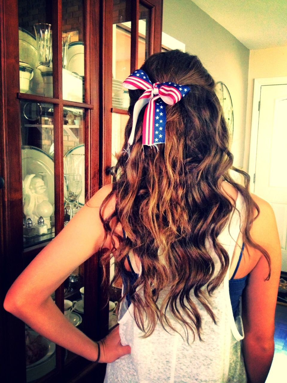 Half up and half down waves with umerica bow hair pinterest
