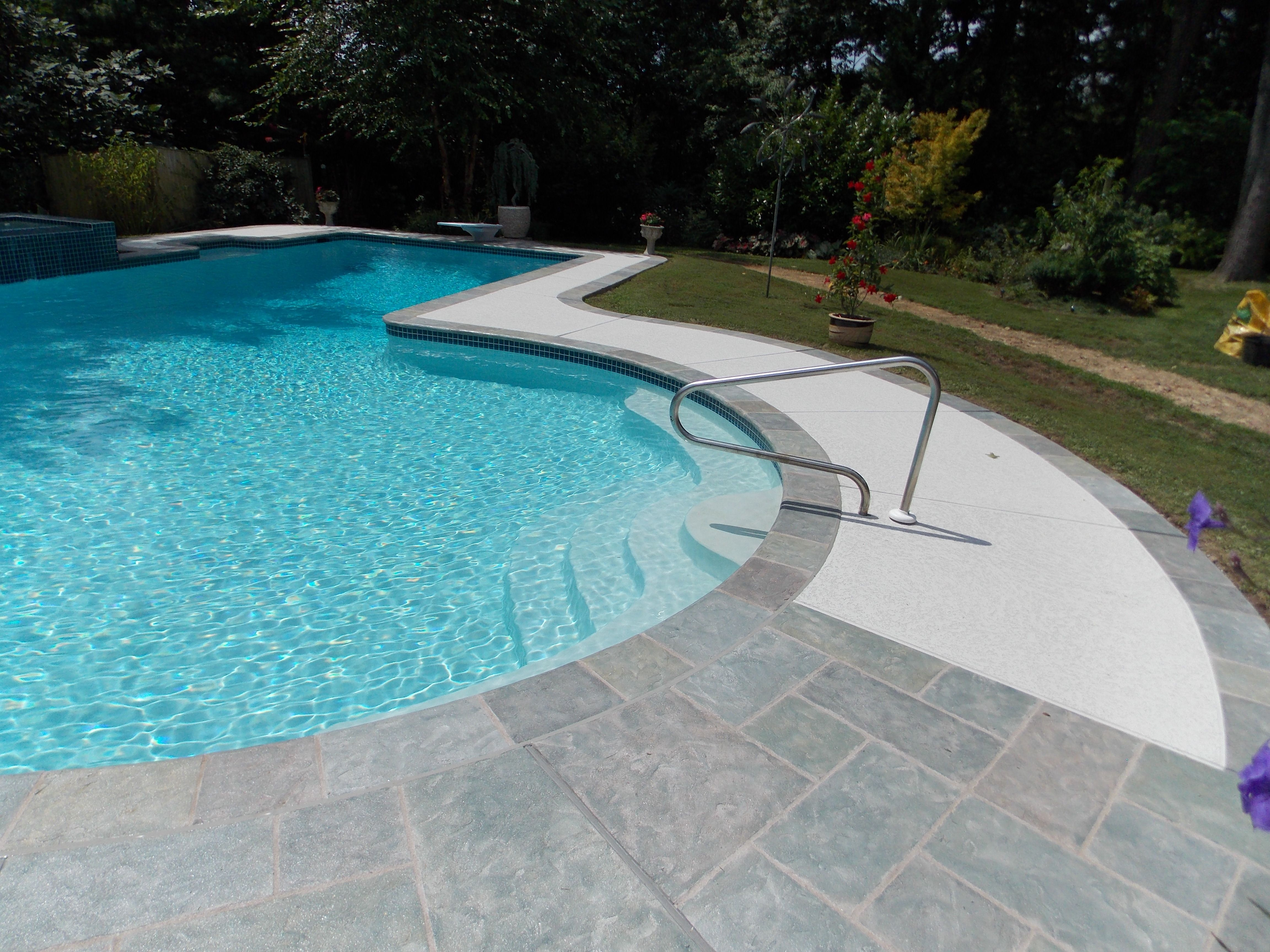 Nothing Frames Sparkling Pool Better Than A Stamped Concrete Pool Deck It Is Safe Cool To The Feet And Absolutely Stunnin Pool Decks Concrete Pool Pool Deck