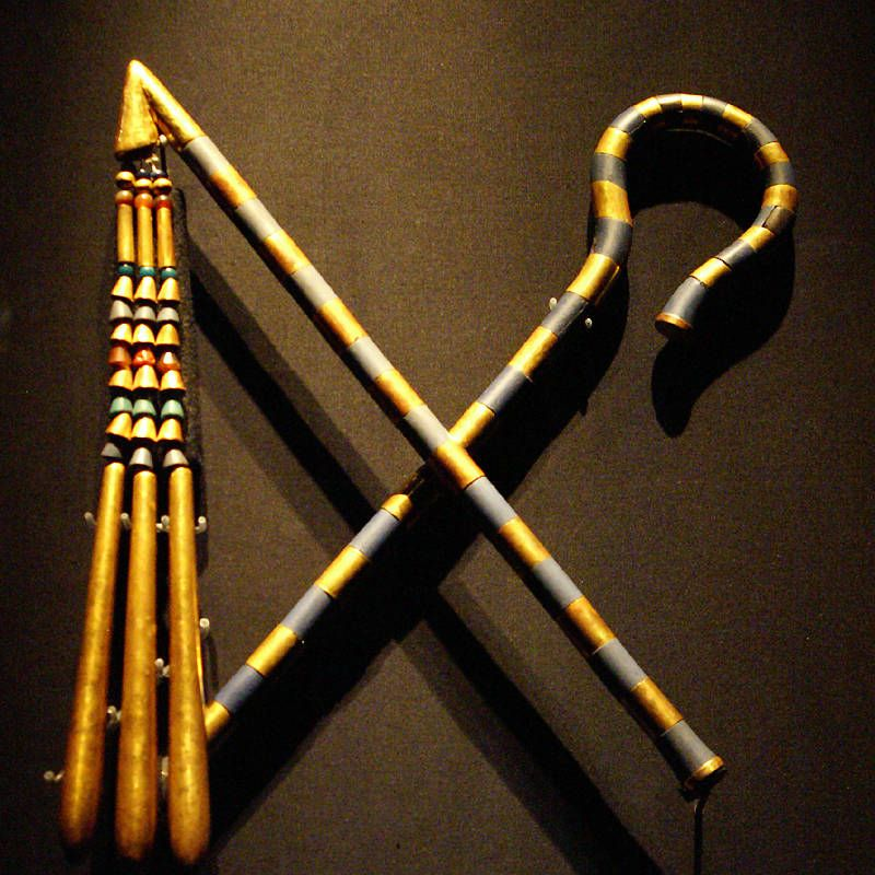 Flail and Crook, Royal Symbols from Tutankhamun's Burial are made of gold, copper alloy, glass, wood and carnelian.the pharaoh carried these - symnbols of his royal power.