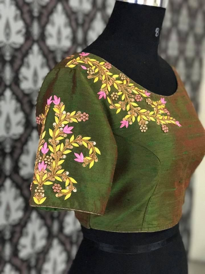 f333fba17b348 Lovely green color raw silk designer blouse with stunning floret lata  design hand embroidery thread work on yoke. 06 September 2017