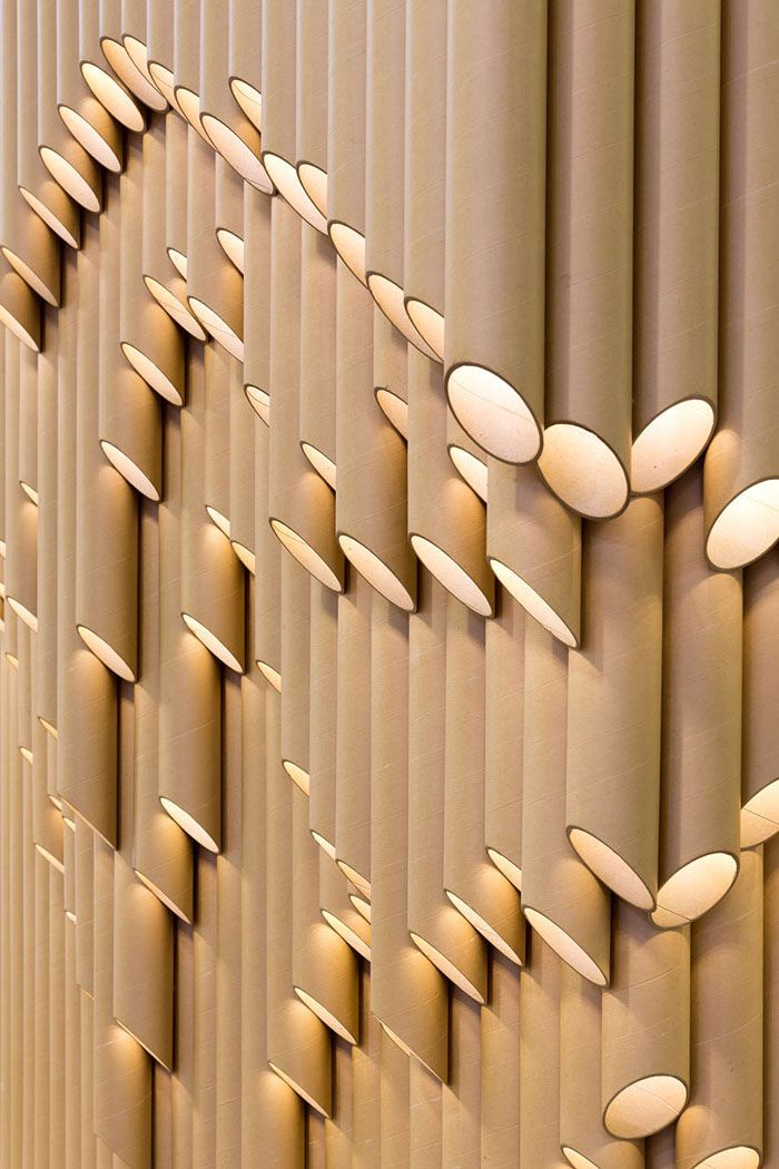 This can be a feature wall light made with cardboard roll or pvc pipe:  Design