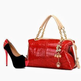 Red patent leather handbag w/dangles. Nice shoe too!
