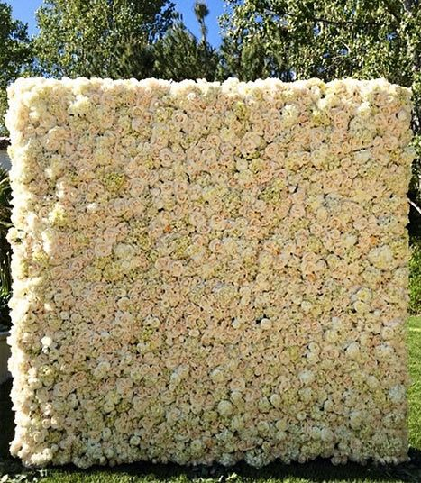 Kanye West gives Kim Kardashian a wall of flowers for Mother's Day. flower wall. wedding idea.