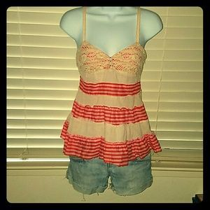 I just added this to my closet on Poshmark: *Amazing Free People Tank!*. Price: $45 Size: 2