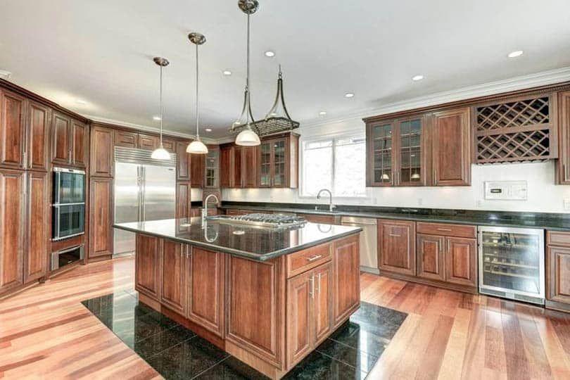 Laminate Vs Hardwood Flooring Pros And Cons In 2020 Hickory Hardwood Floors Hardwood Kitchen Design