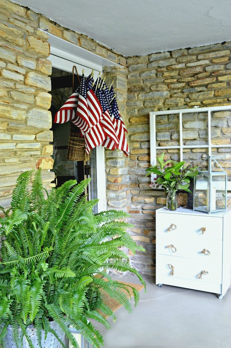How to add a bit of red, white and blue to your front door with this quick and easy American flag display using a hanging basket and flags.