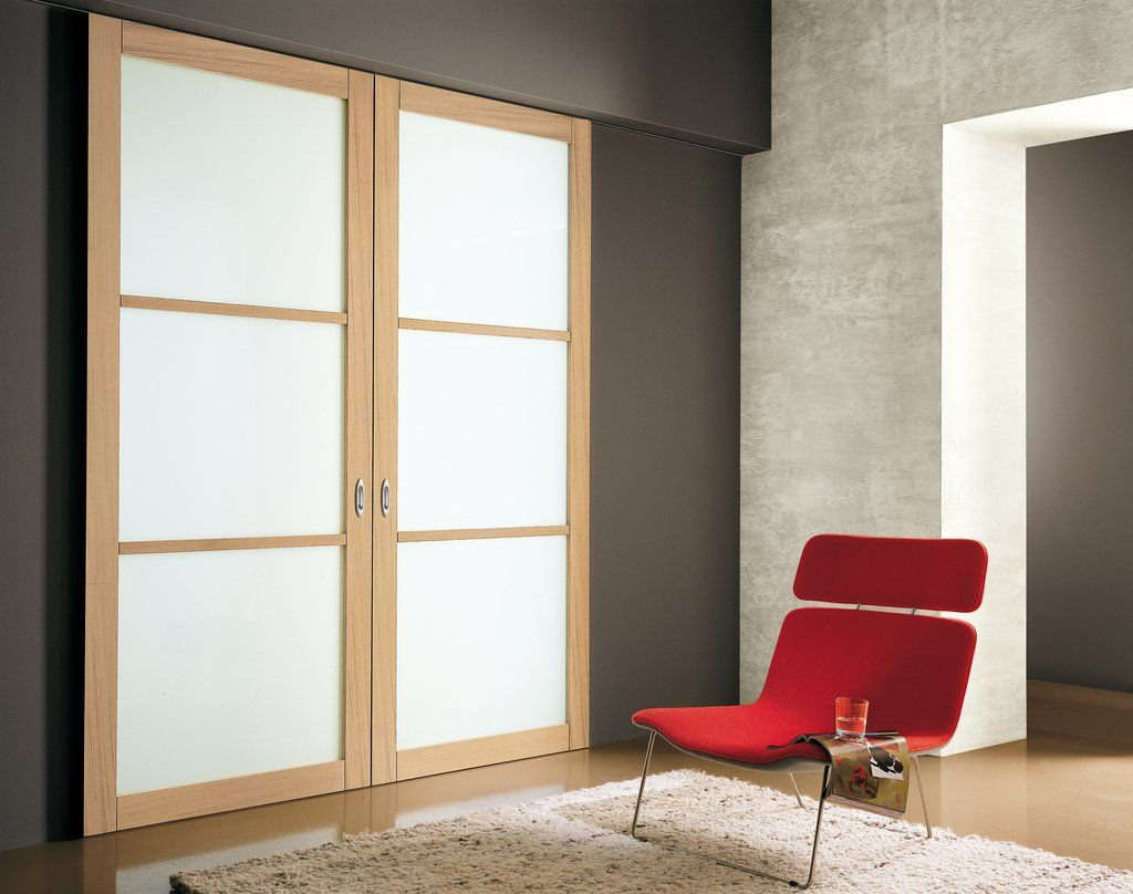 Modern Interior Sliding Door Featuring A Bianco Latte Panel With Oak
