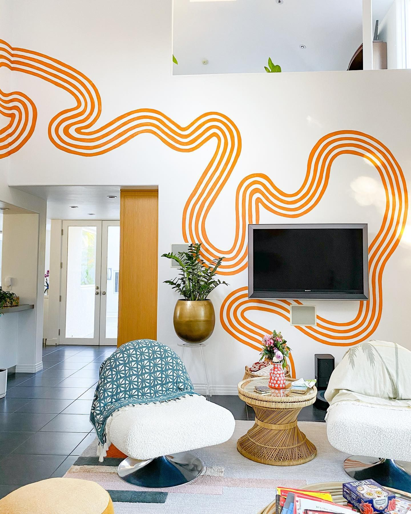 Colorful Gallery Wall with a Warm, Sunset Mural