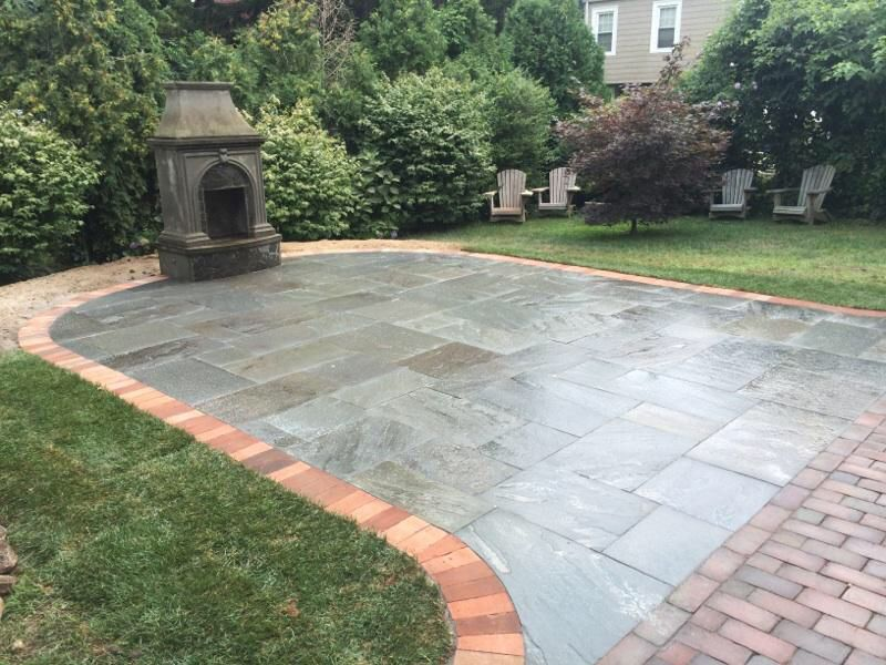 Dry Laid Natural Cleft Bluestone Patio With A Soldier Brick Border